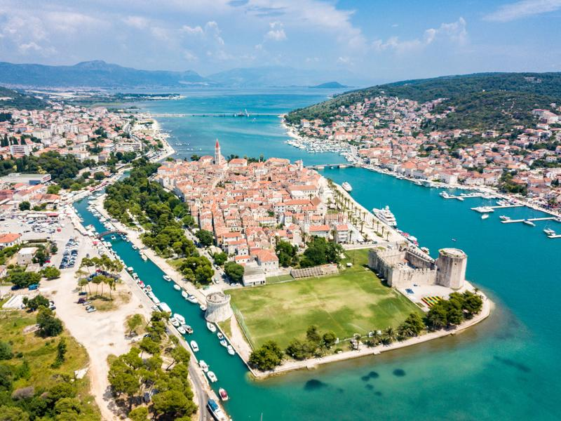 Aerial view of touristic old Trogir, historic town on a small island and harbour on the Adriatic coast in Split-Dalmatia, Croatia. stock photo