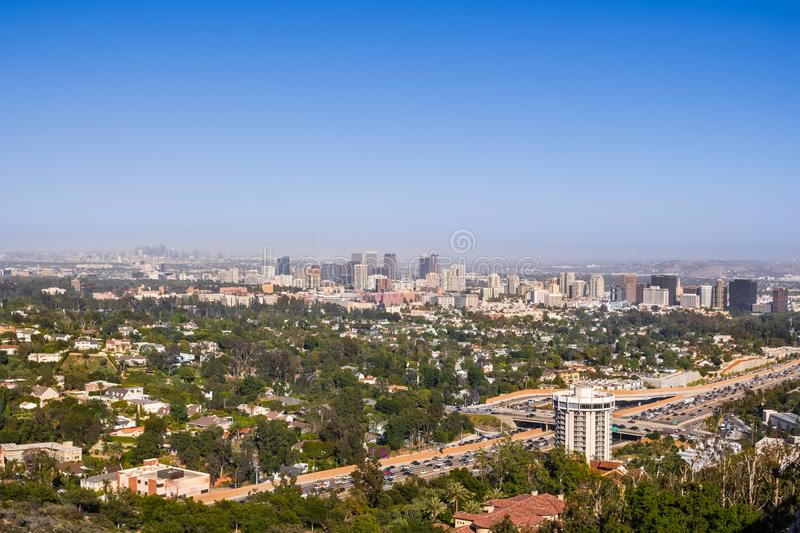 Aerial view towards the skyline of Century City commercial district; downtown area skyscrapers visible in the background; highway. 405 and residential area in stock image