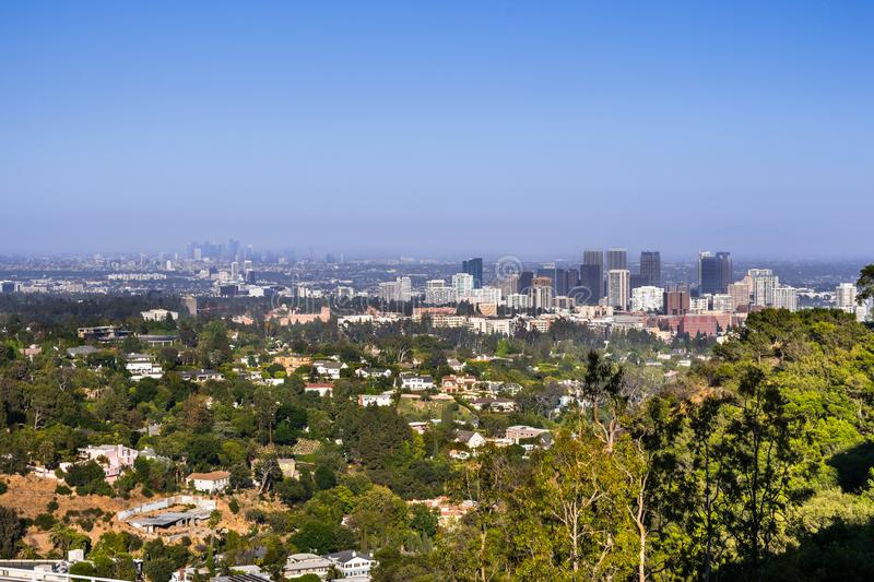 Aerial view towards the skyline of Century City commercial district; the downtown area skyscrapers visible in the background;. Residential neighborhood in the stock images