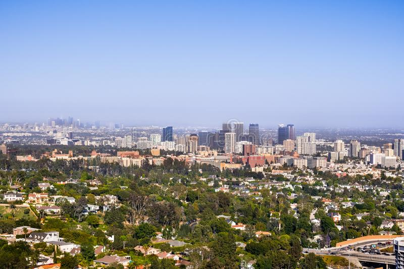 Aerial view towards the skyline of Century City commercial district; the downtown area skyscrapers visible in the background;. Residential neighborhoods in the stock image