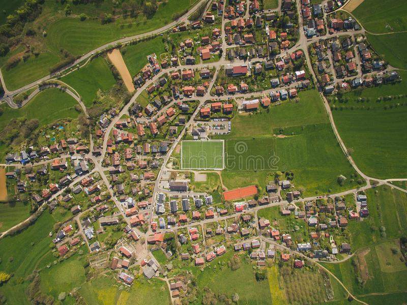 Aerial view of town and green soccer stadium royalty free stock photo