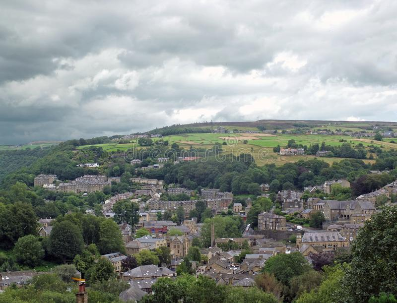 Aerial view of the town of hebden bridge in west yorkshire surrounded by pennine hills and fields stock photo