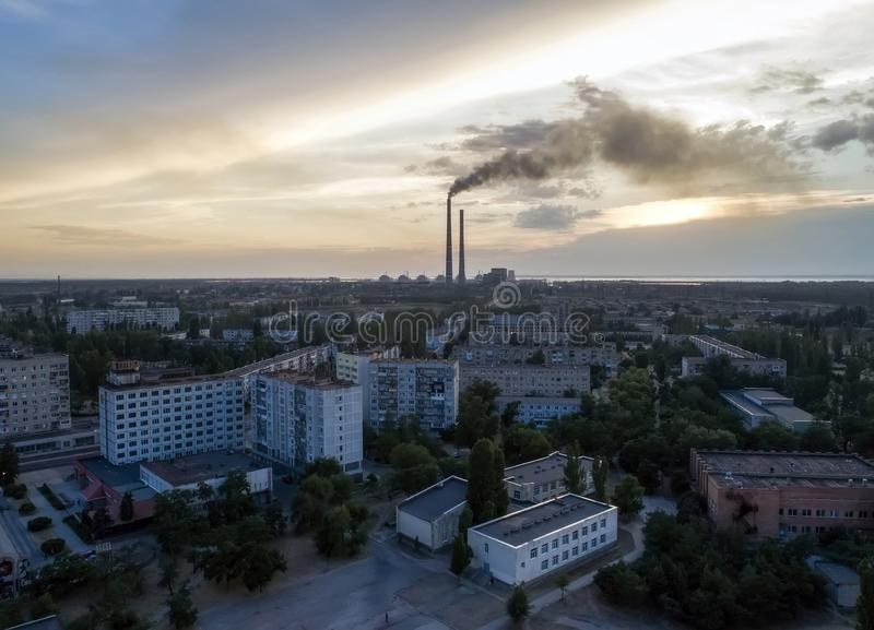 Aerial view of town, nuclear power station, thermal power station and sky at sunset. Aerial photography. Energodar, Ukraine royalty free stock images