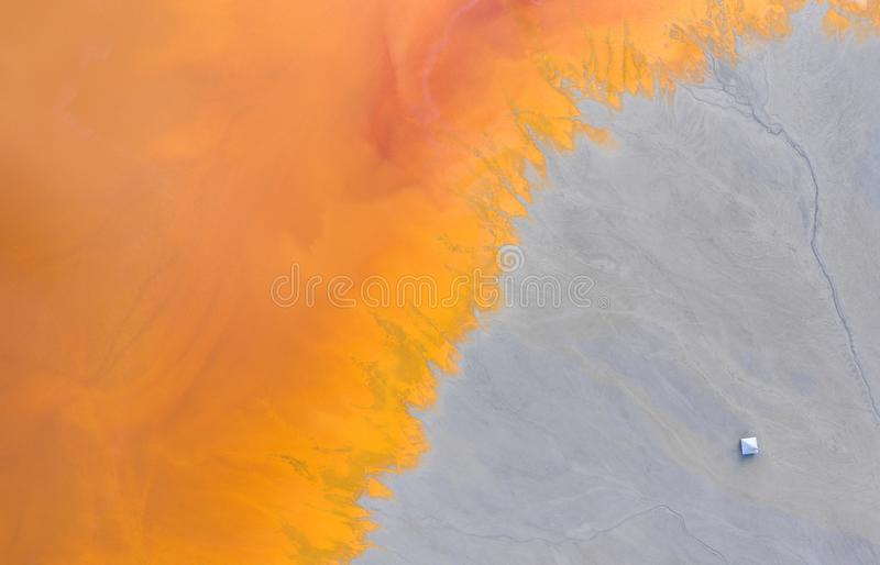 Aerial view of a toxic waste lake flooded a church royalty free stock photography