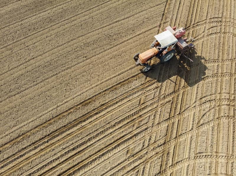 Aerial view of a tractor plowing the fields, aerial view, plowing, sowing, harvest. Agriculture and Farming, campaign. stock photo