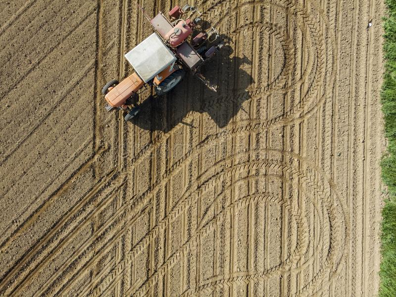 Aerial view of a tractor plowing the fields, aerial view, plowing, sowing, harvest. Agriculture and Farming, campaign. stock photography