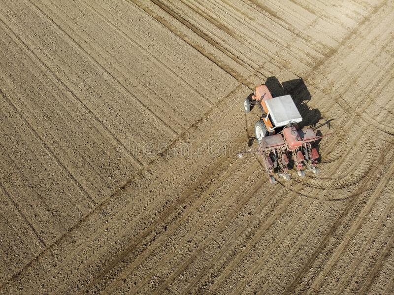 Aerial view of a tractor plowing the fields, aerial view, plowing, sowing, harvest. Agriculture and Farming, campaign. stock photos