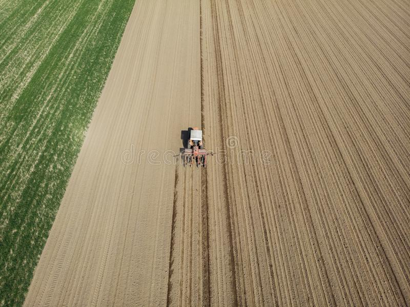 Aerial view of a tractor plowing the fields, aerial view, plowing, sowing, harvest. Agriculture and Farming, campaign. royalty free stock image