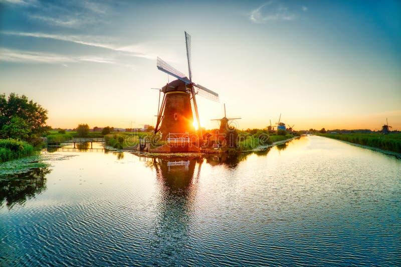 Windmills at sunset in Kinderdijk, The Netherlands stock images
