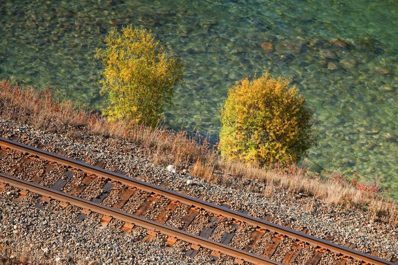 Aerial view of train tacks and a river stock images