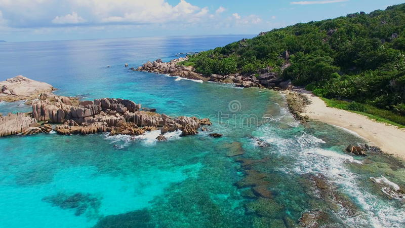 Aerial view of tropical paradise beach with white sand and crystal clear water of Indian Ocean La Digue Island, Seychelles stock video footage