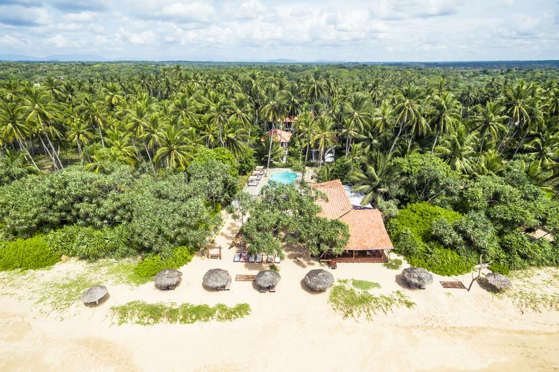 Aerial view of tropical beach with lonely hotel in Sri Lanka stock photo