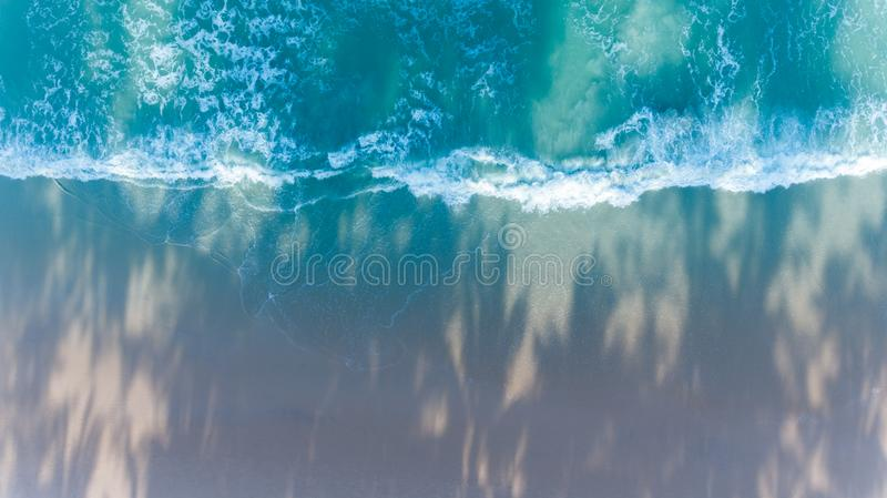 Aerial view of tropical beach with wave in morning stock photography