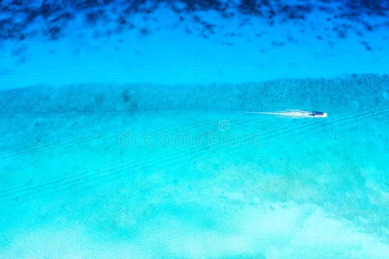 Aerial view of tropical caribbean sea and boat on blue turquoise water. Dominican Republic stock photo