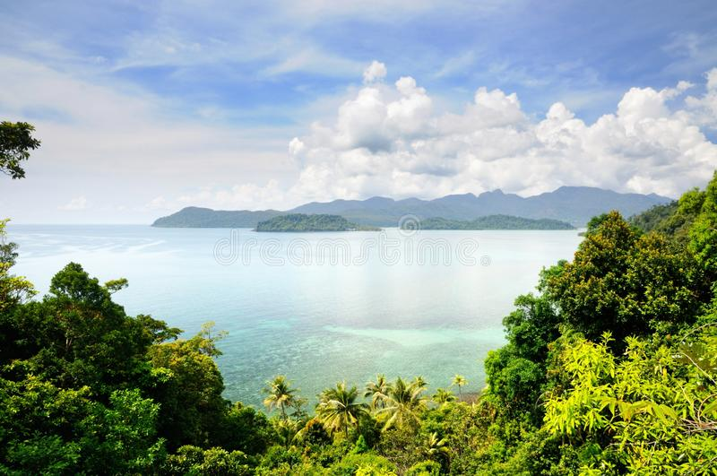 Aerial view on the tropical island, turquoise sea, mountains, blue sky and scenic clouds at the Koh Chang island, Thailand. stock photos
