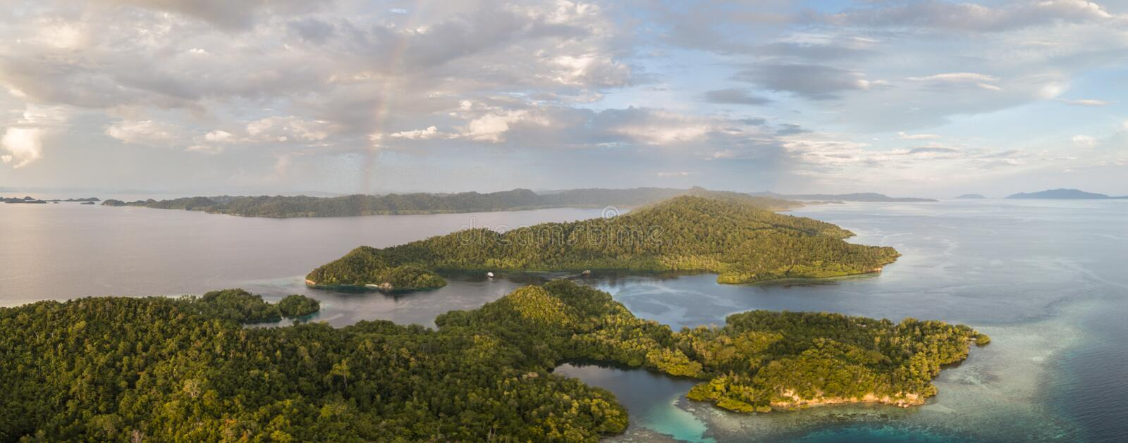 Aerial View of Tropical Islands in Raja Ampat. Clouds drift above a beautiful set of islands in Raja Ampat, Indonesia. This tropical region is known as the ` royalty free stock photography