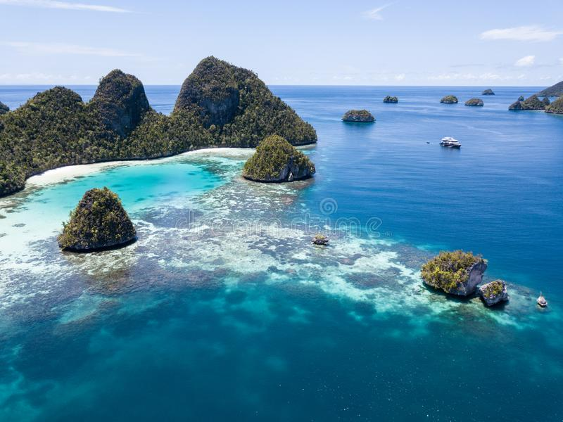 Aerial View of Tropical Lagoon and Islands in Raja Ampat. Limestone islands rise from a gorgeous lagoon in Wayag, Raja Ampat, Indonesia. This remote, tropical royalty free stock images