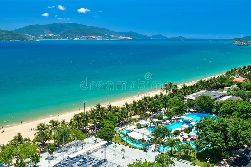 Aerial view at tropical resort on the beach with blue water and island in ocean royalty free stock photography