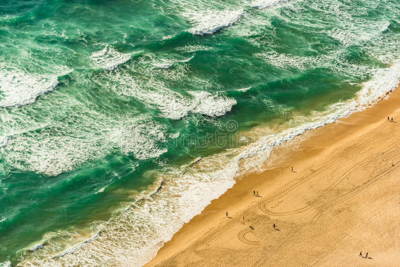 Aerial view of tropical sandy beach ans sea, ocean waves royalty free stock photography