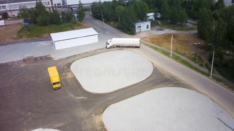 Aerial view of trucks parked in front of industry building. Clip. Aerial. Aerial Top View of White Semi Truck with Cargo royalty free stock photography
