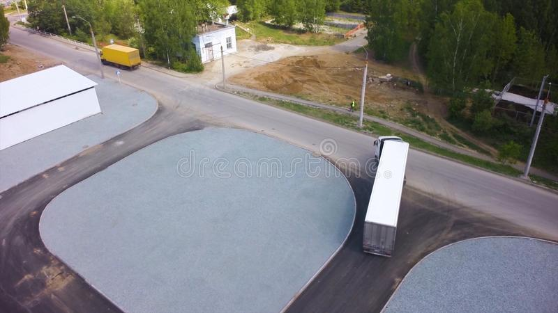 Aerial view of trucks parked in front of industry building. Clip. Aerial. Aerial Top View of White Semi Truck with Cargo royalty free stock image