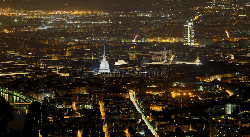 Aerial view of Turin in Italy with the illuminated Mole Antonell royalty free stock image
