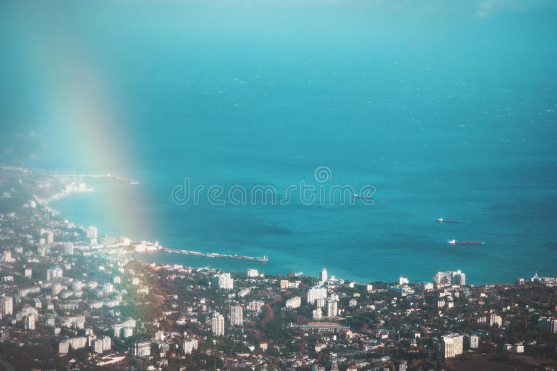 Aerial view of turquoise Sea and port city with rainbow. Beautiful Landscape stock images