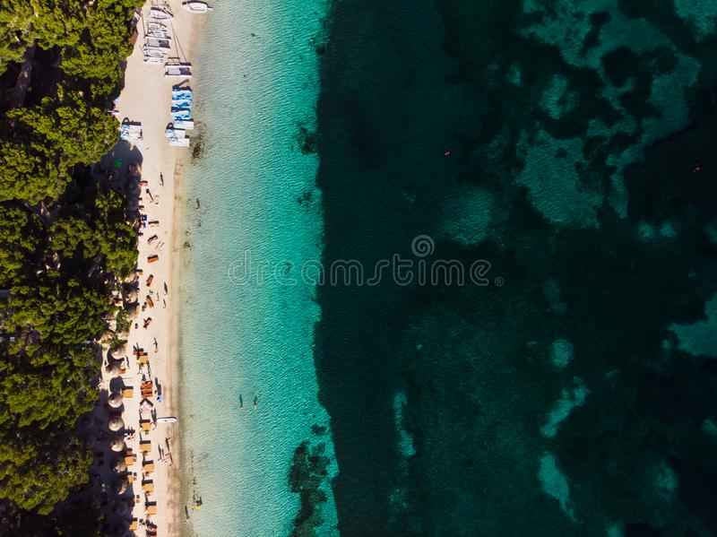 Aerial view of turquoise water of Balearic sea and green nature at Formentor beach, Palma de Mallorca island, Spain royalty free stock images