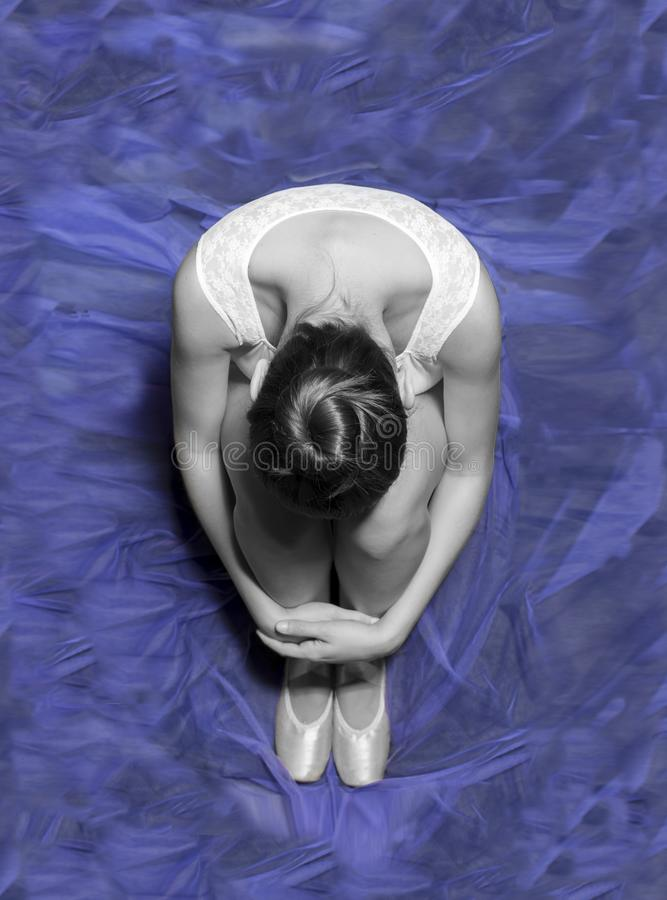 Aerial view of a unrecognizable ballet dancer sitting on floor royalty free stock images