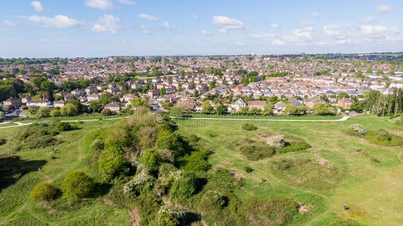 An aerial view of an urban area along a park under a majestic blue sky and white clouds.  royalty free stock photos