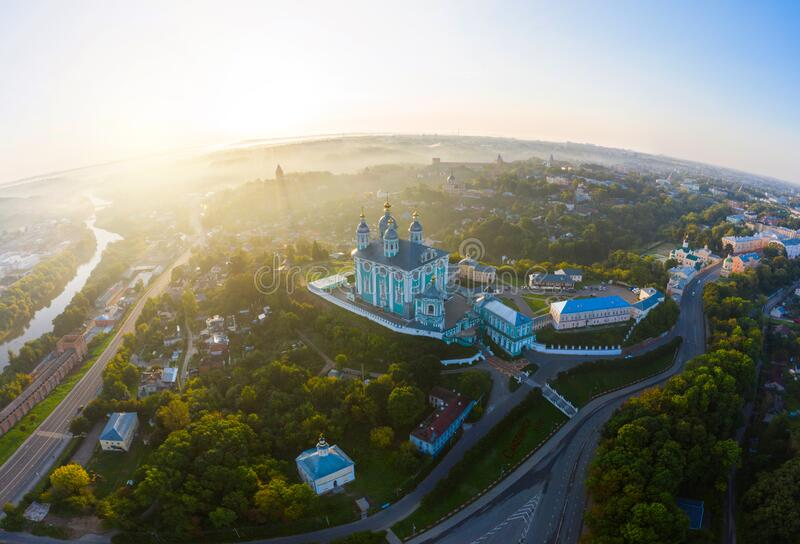 Aerial view of Uspenskiy Cathedral in Smolensk, Early summer morning and fog over the city in the rays of the rising sun stock image