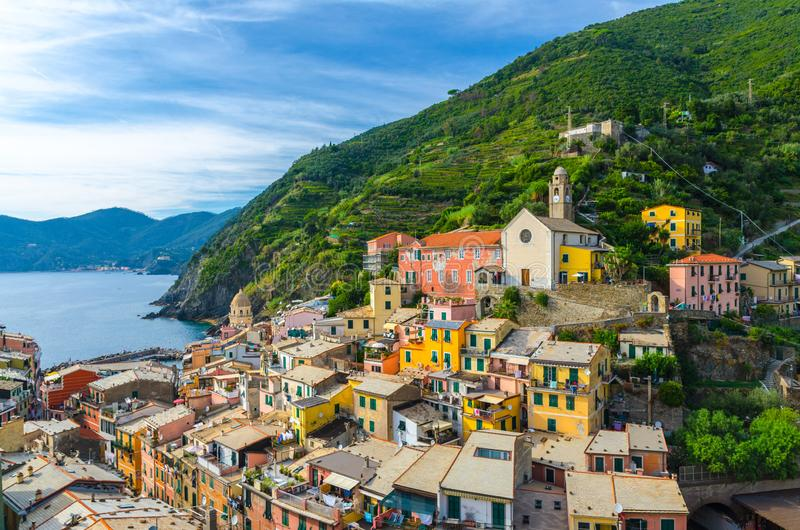 Aerial view of Vernazza village with typical colorful multicolored buildings houses, harbor, marina, green hills and Genoa Gulf, L royalty free stock image