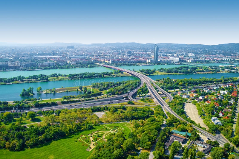 Aerial view of Vienna city, Austria. With Donau park on foreground and Brigittenauer bridge across the Danube river in the middle royalty free stock images