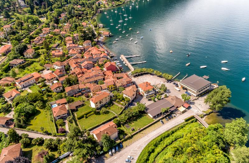 Aerial view of the village and the small harbor of Castelveccana, located on the shore of Lake Maggiore in the province of Varese. Aerial view of the village stock photo