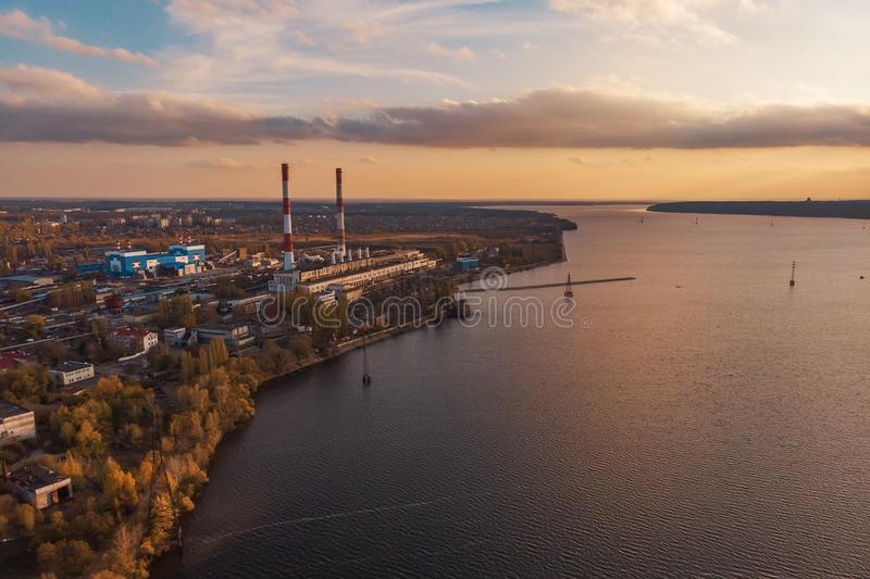 Aerial view of Voronezh Power Plant or station with high chimneys near water reservoir at sunset, drone photo royalty free stock photos