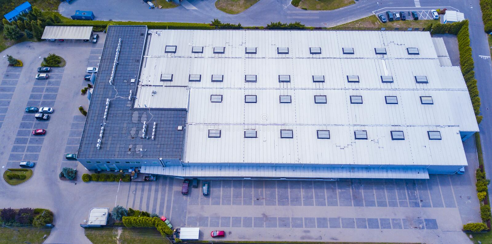 Aerial view of warehouse storages or industrial factory or logistics center from above. Top view of industrial buildings and royalty free stock photos