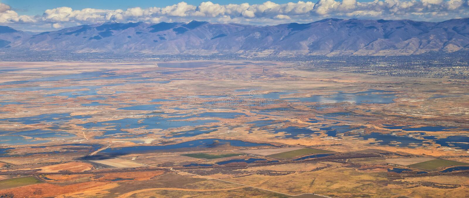 Aerial view of Wasatch Front Rocky Mountain landscapes on flight over Colorado and Utah during winter. Grand sweeping views near t stock photo