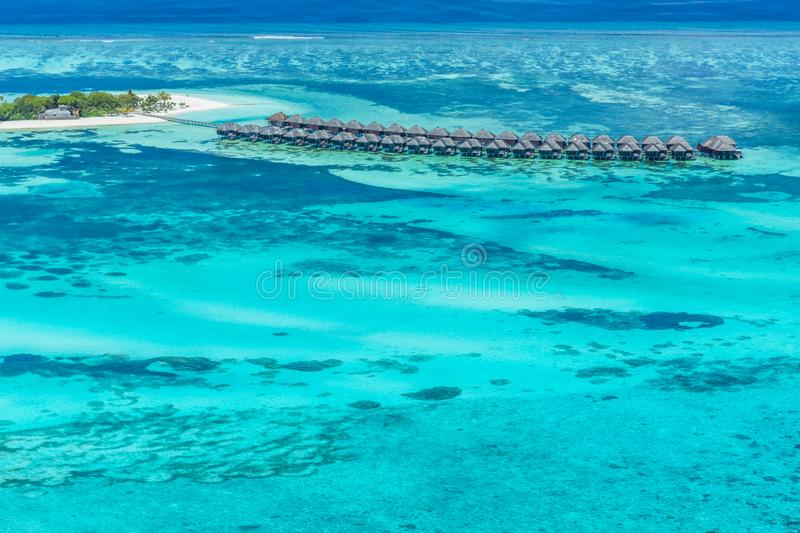 Panoramic landscape seascape aerial view over a Maldives Male Atoll islands. White sandy beach seen from above. Aerial view of water bungalow and blue sea sky stock images