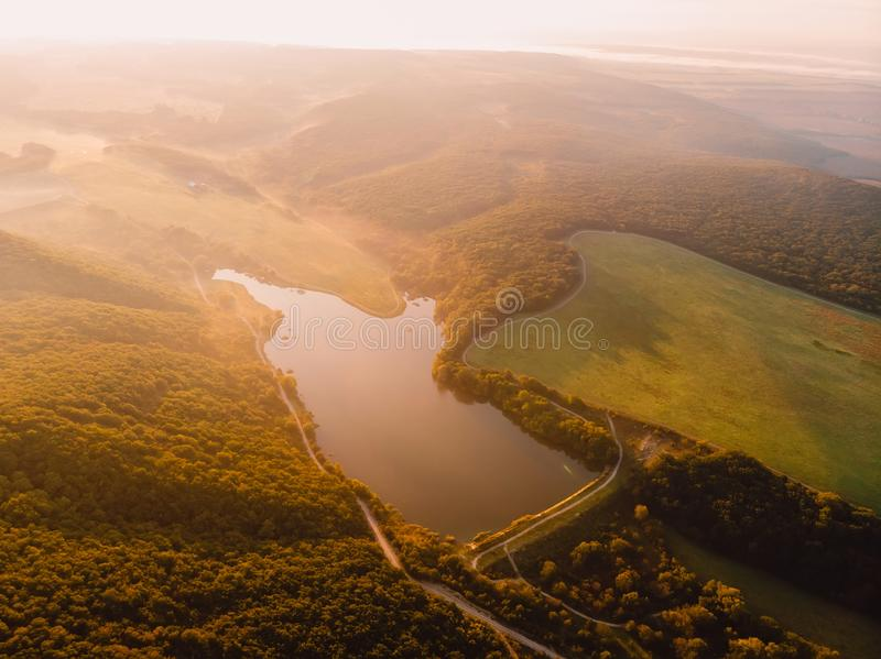 Aerial view of water lake and warm sunset or sunrise stock photography
