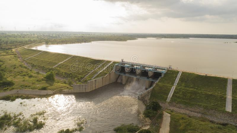 Aerial view of water reservoir with full of water and one of flood gate open at raichur, India.  royalty free stock photography