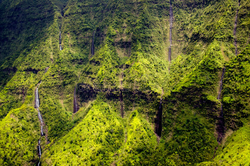 Aerial view of water streams, waterfalls and lush landscape, Kauai royalty free stock photography