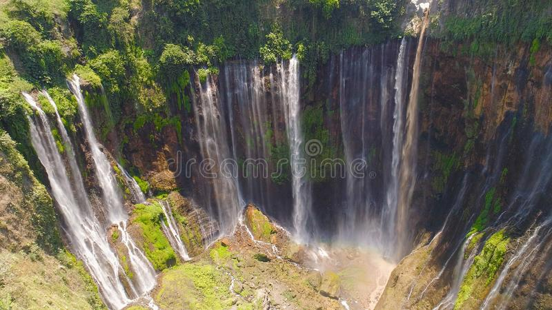Waterfall Coban Sewu Java Indonesia. Aerial view waterfall coban sewu in Java, indonesia. waterfall in tropical forest by drone Tumpak Sewu stock photo