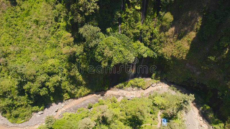 Waterfall Coban Sewu Java Indonesia. Aerial view waterfall coban sewu in Java, indonesia. waterfall in tropical forest by drone Tumpak Sewu royalty free stock photos