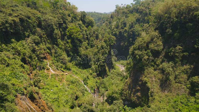 Waterfall Coban Sewu Java Indonesia. Aerial view waterfall coban sewu in Java, indonesia. waterfall in tropical forest by drone Tumpak Sewu royalty free stock photography