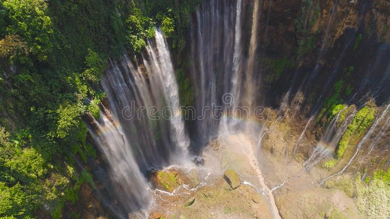 Waterfall Coban Sewu Java Indonesia. Aerial view waterfall coban sewu in Java, indonesia. waterfall in tropical forest by drone Tumpak Sewu stock images