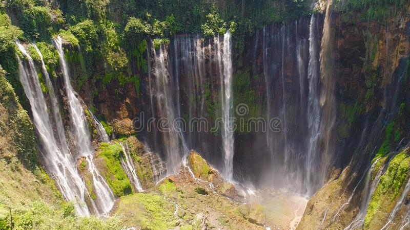Waterfall Coban Sewu Java Indonesia. Aerial view waterfall coban sewu in Java, indonesia. waterfall in tropical forest by drone Tumpak Sewu royalty free stock photo