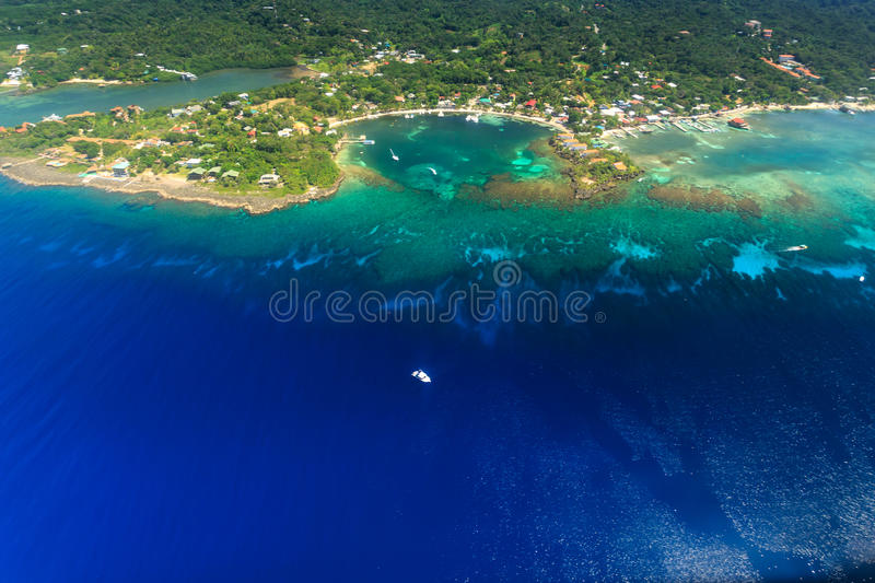 Aerial view of West End, Roatan island and tropical coral reef. Aerial view of the town of West End, Roatan island and tropical coral reef royalty free stock image