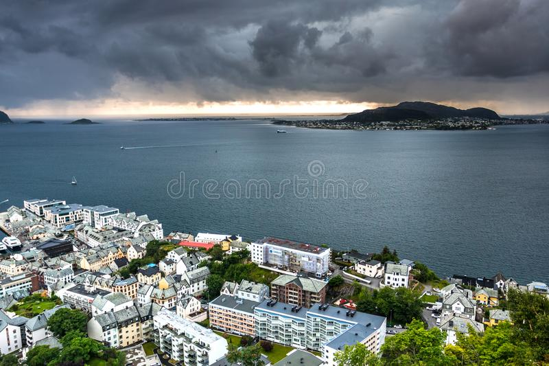 Aerial View of Western Alesund and The Ocean with Dramatic Sky after A Rain. Image of Alesund after the rain in Summer taken from Mount Aksla Viewpoint. Alesund royalty free stock photography