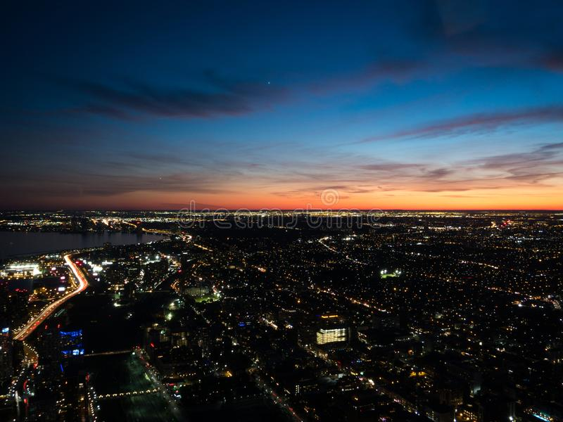 Aerial view of western Toronto at sunset with lights and car traces visible stock photography