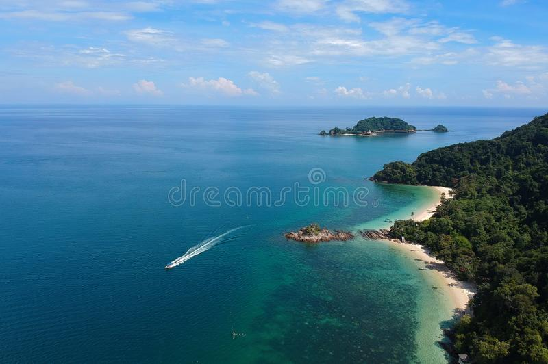 Aerial View of White Boat Traveling Near Green Island stock photos